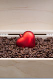 Coffee beans and red heart in an open box. Coffee beans and red heart in an open wooden box Stock Photos