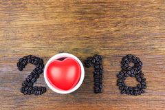 2018 coffee beans and  red heart  on wood Stock Image