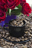 Coffee beans and red roses Royalty Free Stock Photo