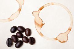Coffee beans and ring stain Royalty Free Stock Images