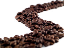 Coffee Beans River 2. Coffee Beans flowing like a stream isolated on White Royalty Free Stock Images