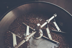 Coffee beans in roast machine, arabica roasted coffee  ,color vi. Ntage style. Thailand Stock Photos