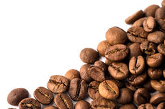 Coffee Beans. Roasted brown coffee beans on white isolated background stock photos