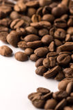 Coffee Beans. Roasted brown coffee beans on white isolated background stock photo