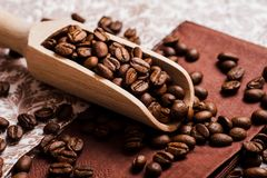 Coffee beans.Roasted coffee beans goals.Packaging for coffee. Coffee beans.Roasted coffee beans goals.Coffee beans and an old wooden scoop stock photography
