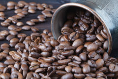 Coffee beans roasted isolated on wooden background close up cut out in cup Stock Photography