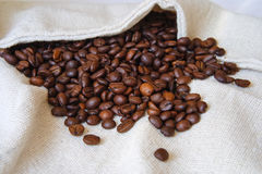 Coffee beans. Roasted coffee beans on a white bag Royalty Free Stock Images