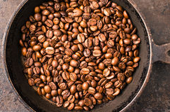 Coffee beans during roasting Stock Photos