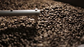 Coffee beans in the roasting machine. Selective stock footage