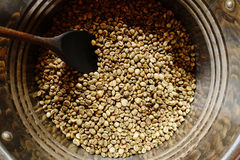 Coffee beans are roasting in pan Royalty Free Stock Photos