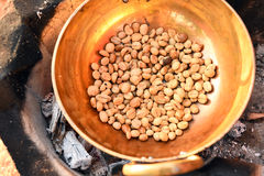 Coffee beans are roasting in pan Stock Photography