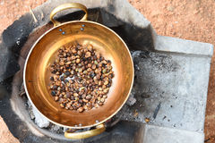 Coffee beans are roasting in pan Royalty Free Stock Photography