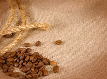 Coffee beans, rope and canvas Stock Photos
