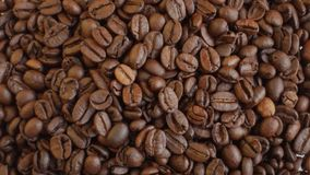 Coffee beans on rotating stand closeup stock footage