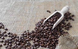 Coffee beans on the rough burlap Stock Photo