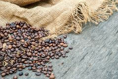 Coffee beans on a rough sacking royalty free stock photo