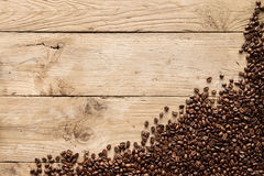 Coffee beans on rustic wood background Stock Image