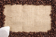 Coffee beans and sachet Stock Photo