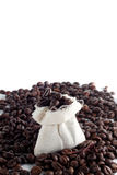 Coffee beans in a sack. With a lot of beans around it Stock Image