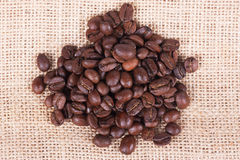 Coffee beans on sack Stock Image