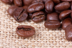 Coffee beans on sack Royalty Free Stock Image