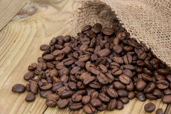 Coffee Beans in a sack Stock Images