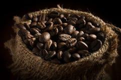 Coffee beans in sack bag. Stock Photos