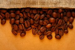 Coffee beans with sack Stock Images