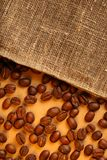 Coffee beans with sack Stock Photography