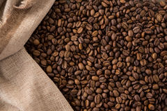 Coffee beans in sack Stock Images