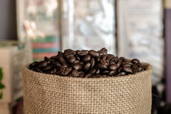 Coffee beans in a sack colored vintage Royalty Free Stock Image