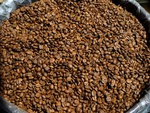Coffee beans in a sack. Dried coffee sold by the kilo.  stock photography