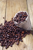 Coffee beans in a sack and spilled Royalty Free Stock Image
