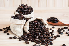 Coffee beans sack. With spoon over wooden background Stock Photo