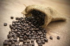 Coffee beans with sack Stock Photos