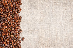 Coffee beans and sackcloth Stock Image