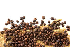 Coffee beans and sackcloth Royalty Free Stock Images