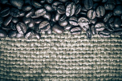 Coffee beans on sackcloth background. tinted Stock Photo