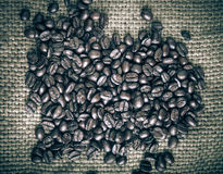 Coffee beans on sackcloth background. tinted Royalty Free Stock Photo