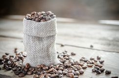 Coffee beans in the sackcloth bag Stock Photos