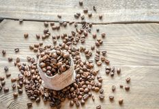 Coffee beans in the sackcloth bag Royalty Free Stock Photography