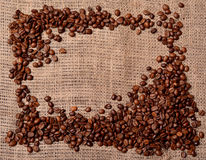Coffee beans on sackcloth. Frame Royalty Free Stock Image
