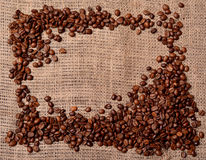 Coffee beans on sackcloth Royalty Free Stock Photography