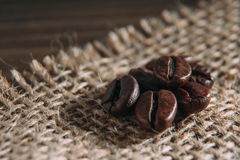 Coffee beans on sackcloth Stock Photo