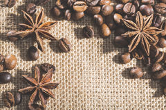 Coffee beans on sackcloth with spices anise Royalty Free Stock Image
