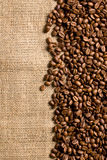 Coffee beans on sackcloth Stock Images