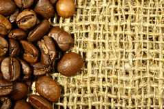 Coffee beans on sacking Stock Photography