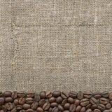 Coffee beans on sacking Stock Photos
