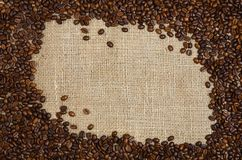 Coffee beans on sacking background Royalty Free Stock Image