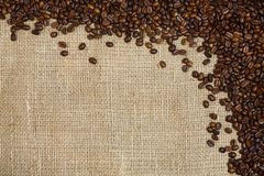 Coffee beans on sacking background Royalty Free Stock Photo